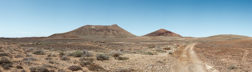 Off road track in the middle of dry, barren, volcanic landscape, the Canary Islands