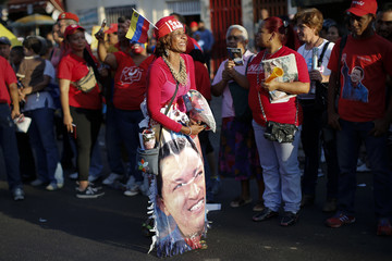 Supporters of Venezuela's President Hugo Chavez cheer outside military hospital after his surprise return to Caracas