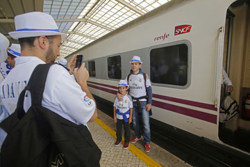 Real Madrid supporters arrive to attend their Champions League final soccer match against Atletico Madrid, in Lisbon