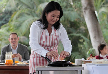 Peruvian presidential candidate Keiko Fujimori prepares breakfast for her daughters during a breakfast meeting in Lima