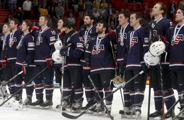 Team USA's players listen to national anthem after their victory over Finland in the 2013 IIHF Ice Hockey World Championship bronze medal match at the Globe Arena in Stockholm