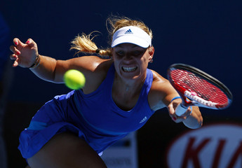 Angelique Kerber of Germany hits a return to Alison Riske of the U.S. during their women's singles match at the Australian Open 2014 tennis tournament in Melbourne