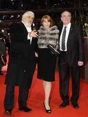 German actress Berger poses with her partner Verhoeven and actor Adorf opening of 60th Berlinale International Film Festival in Berlin