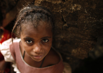 A girl from the Akhdam community poses in a slum area in Sanaa