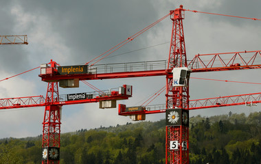 The flower logo of Swiss construction company Implenia is seen  on cranes in Spreitenbach