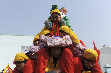 Performers form a human pyramid on the third day of the Chinese Lunar New Year at Baixiang village of Wuhu
