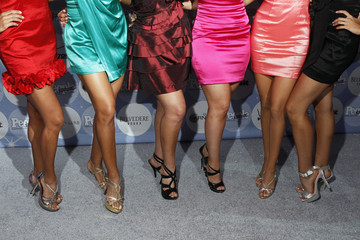 """Women's legs are lit as they arrive to attend the People En Espanol's """"50 Most Beautiful"""" event in New York"""