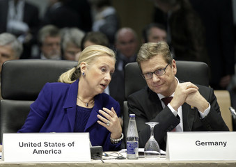 U.S. Secretary of State Clinton confers with German Foreign Minister Westerwelle during an international conference of the OSCE in Vilnius