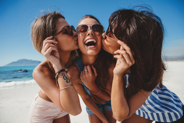Female friends having fun on the beach