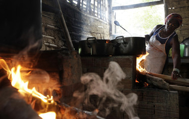 "A woman cooks the Brazilian traditional dish called ""Feijoada"" at the community of Quilombo Sao Jose, descendants of African slaves, during Afro-Brazilian culture celebrations in Valenca"