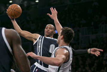 Oklahoma City Thunder Kevin Durant stuffs ball against Brooklyn Nets in NBA game in New York