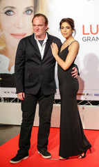 Director Quentin Tarantino and model and singer Daniella Pick arrive at the opening day of the Lumiere Festival in Lyon