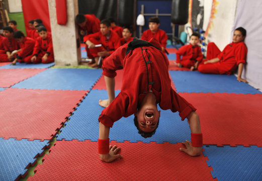 Palestinian boy shouts as he participates during a class at the Red Dragon martial arts club in Beit Lahiya