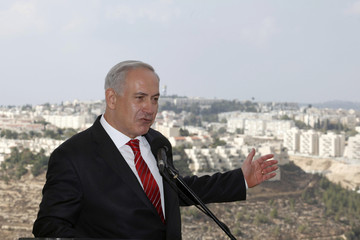 Israel's Prime Minister Netanyahu speaks to the media during his visit to the Israeli settlement of Gilo