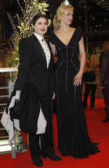 Jury president and actress Rossellini and actress Hoss arrive at red carpet for opening U.S. movie 'True Grit' at 61st Berlinale International Film Festival in Berlin