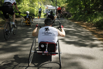 "Nickolas Edinger, an amputee veteran from the war in Afghanistan, participates in a ride of ""Wounded Warriors""  around Annapolis"