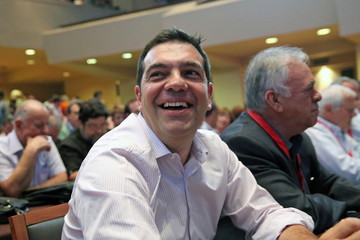 Greek Prime Minister Tsipras laughs during a central committee of leftist Syriza party in Athens