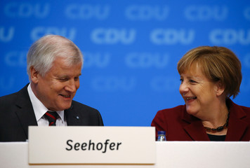 German Chancellor and leader of the CDU Merkel and Bavarian Prime Minister and head of the CSU Seehofer attend the CDU party congress in Karlsruhe