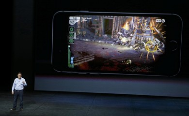 Andy Wafer, CEO of game maker Pixeltoys, discusses the game for the new line of iPhone 6 during an Apple media event in San Francisco, California