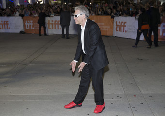 """Director Cronenberg gestures after he arriving at the """"Maps to the Stars"""" gala at the Toronto International Film Festival in Toronto"""