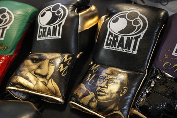 Personalized boxing gloves with the images of Floyd Mayweather Jr.  are displayed on the ring during Mayweather's workout at his gym in Las Vegas