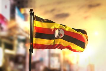 Uganda Flag Against City Blurred Background At Sunrise Backlight Wall mural
