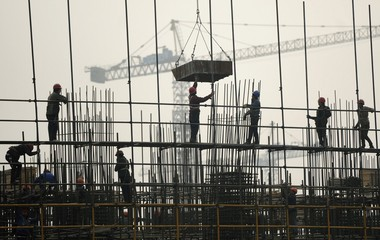 Labourers work on scaffolding at a residential construction site in Hefei, Anhui province