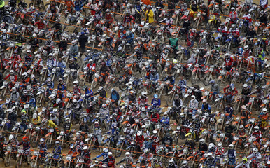 Motocross riders wait for the start of the Red Bull Hare Scramble race during Erzberg Rodeo near the village of Eisenerz in the Austrian province of Styria