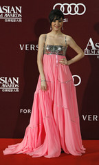 Taiwanese actress Chang Yung-yung, or Sandrine Pinna, poses upon her arrival at the Asian Film Awards in Hong Kong