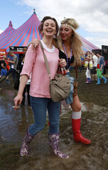 Festival goers walk through the mud at the Hackney Weekend festival at Hackney Marshes in east London