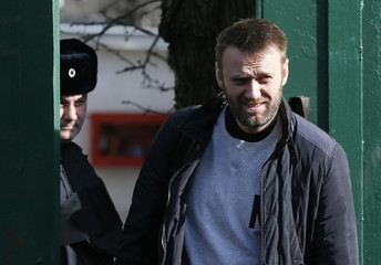 Russian opposition leader Navalny walks out of detention center in Moscow