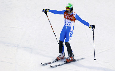 Italy's Innerhofer reacts after the slalom run of the men's alpine skiing super combined event at the 2014 Sochi Winter Olympics