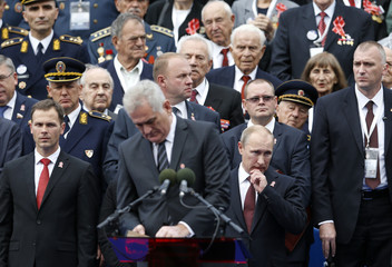 Russian President Putin reacts as as Serbian President Nikolic addresses during a military parade to mark 70 years since the city's liberation by the Red Army in Belgrade