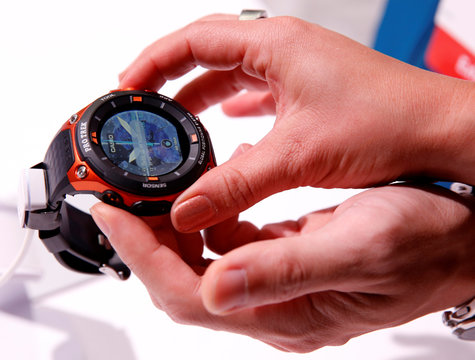 Attendees look over a Casio WSD-F20 Pro Trek Smart watch with built-in GPS during the 2017 CES in Las Vegas