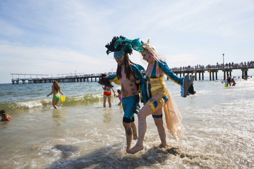 People take part in the Mermaid Parade at Coney Island in the Brooklyn section of New York