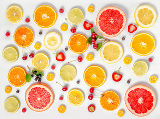 flat lay trendy seamless pattern sliced mixed citrus fruits like background with different berries, concept of healthy eating, dieting, top down