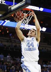 Tar Heels forward Zeller dunks the ball against the Huskies during their third round NCAA men's basketball game in Charlotte