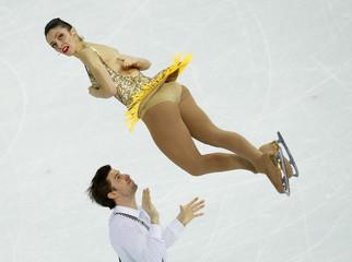 Italy's Stefania Berton and Ondrej Hotarek during pairs short program at the Sochi 2014 Winter Olympics