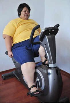 A patient exercises on a stationary bicycle at a weight loss centre in Changchun