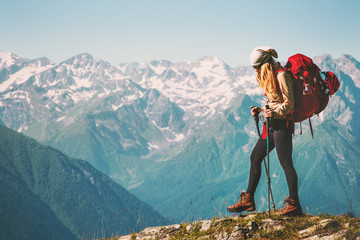 Fototapeta Girl Traveler hiking with backpack at rocky mountains landscape Travel Lifestyle concept adventure summer vacations outdoor obraz
