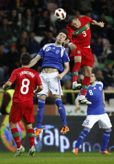 Portugal's Pepe fights for the ball with Finland's Berat Sadik during their international friendly soccer match in Aveiro city stadium