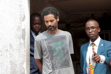 Arthur Simpson-Kent, who is wanted over the murder of a former EastEnders actress and her two children, leaves a district court after a remand hearing in Accra
