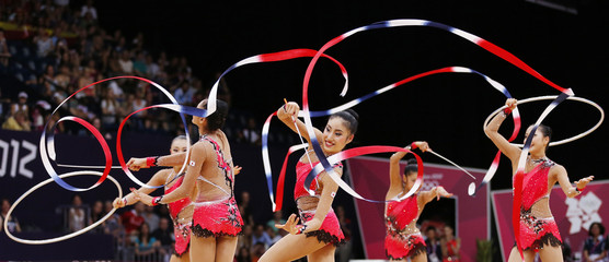 The Japan team compete in their group all-around rhythmic gymnastics qualification match during the London 2012 Olympic Games