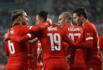 Drmic of Switzerland celebrates with team mates after he scored a goal against Poland during their international friendly soccer match at Wroclaw Stadium in Wroclaw