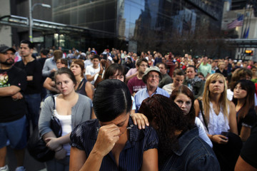People react during ceremonies marking the 10th anniversary of the 9/11 attacks on the World Trade Center in New York