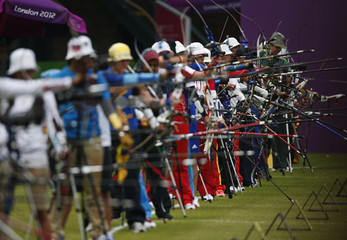 Archers take aim during the women's archery individual ranking round of the London 2012 Olympics Games at the Lords Cricket Ground in London
