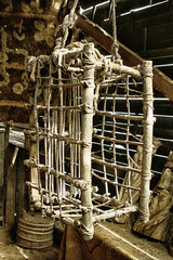 Wooden hanging torture cage