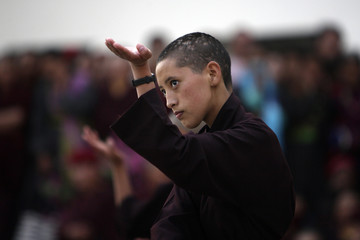 A Buddhist nun takes part in a kung-fu display during the second annual Druk council in Kathmandu