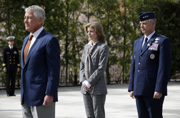 Accompanied by U.S. Ambassador to Japan Kennedy and Commander of U.S. Force Japan Lt. Gen. Angelella, U.S. Secretary of Defense Hagel observes a moment of silence after he laid a wreath at the JSDF Memorial at the Japanese Minister of Defense in Tokyo