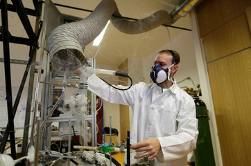 Scientist Frantisek Lizal operates a model of a functioning human lung in Brno